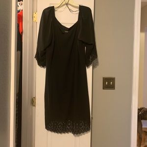 Adorable black dress with lace/eyelet design